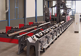 Continuous feed tube and bar blast machine